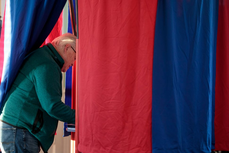 Lance Sanders casts his midterm ballot at Briles Schoolhouse in Peoria Township, Kansas.
