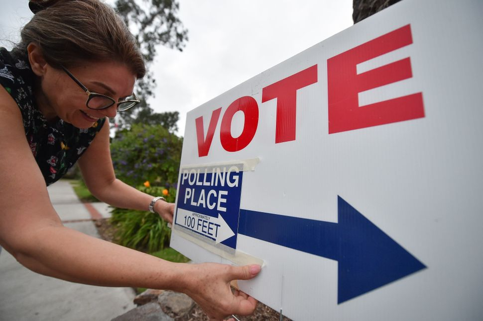Orange County California poll worker Anahita sets up a voting station at Laguna Beach City Hall in Laguna Beach, California.&