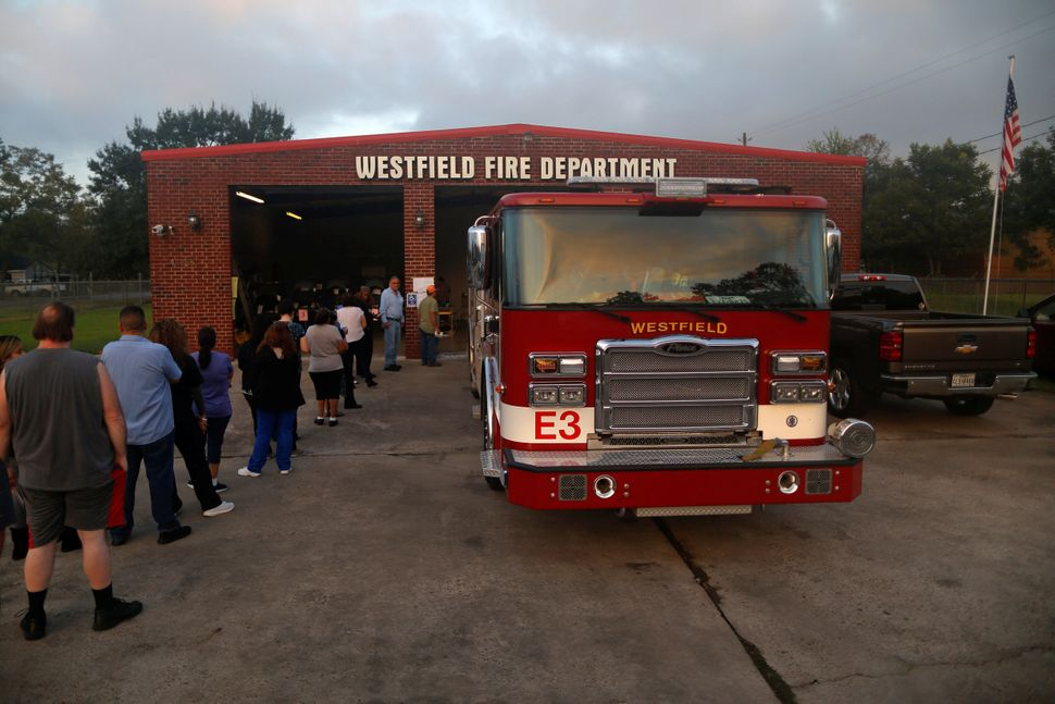Residents wait in line to vote at a fire station in Houston, Texas.