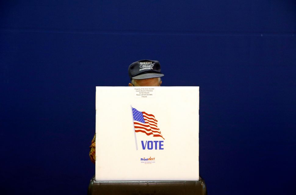 A voter fills out a ballot at a polling place at Lake Shore Elementary School, Tuesday, Nov. 6, 2018, in Pasadena, Maryland.&