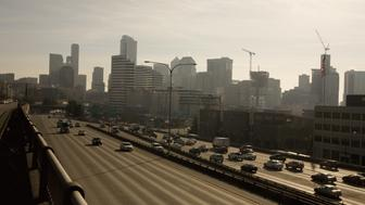 SEATTLE, WA - 2009:  Seattle's downtown city center high rise office buildings adjacent to Interstate highway 5 in the distance are seen in this 2009 Seattle, Washington, city landscape photo. (Photo by George Rose/Getty Images)