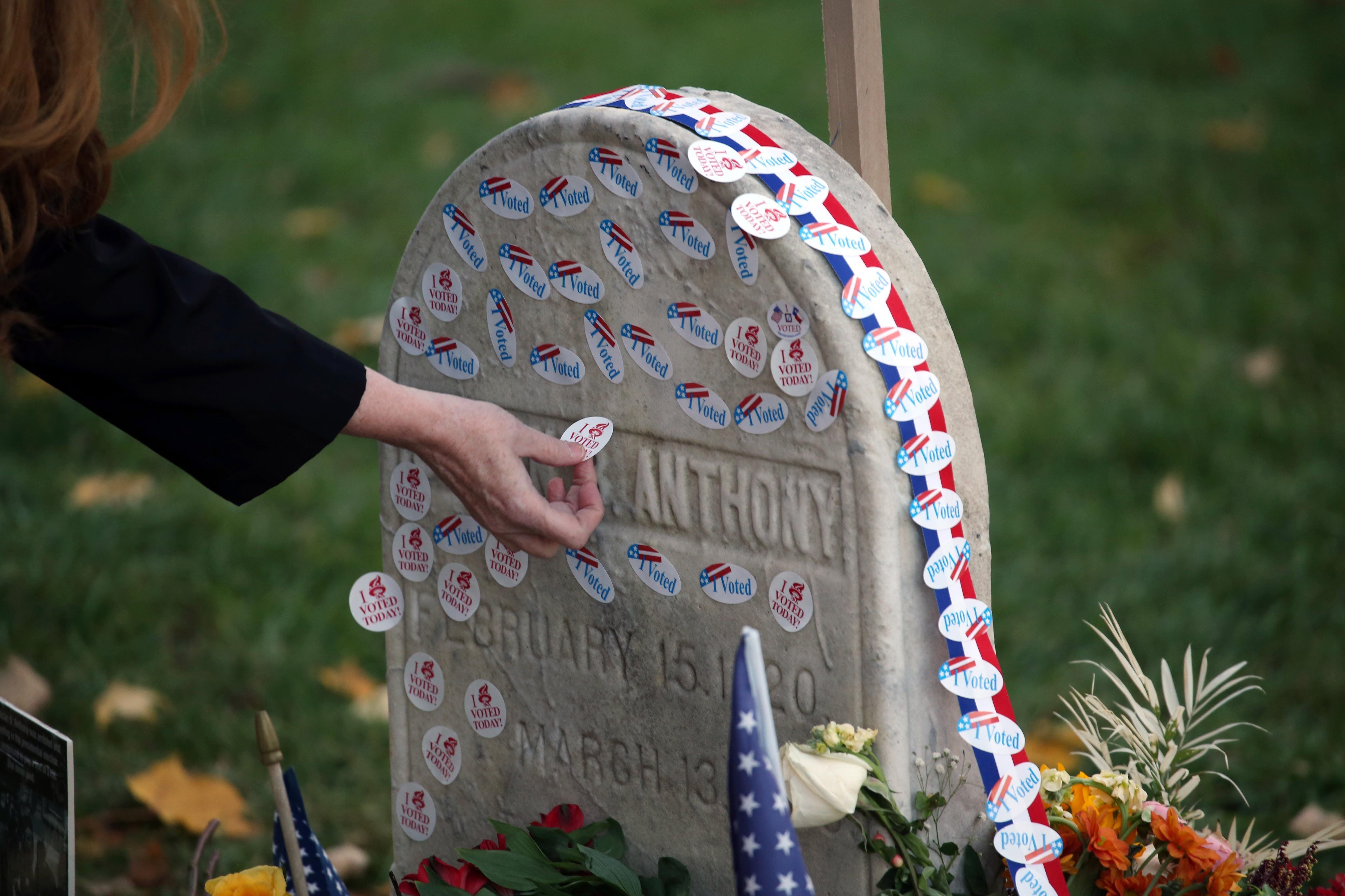 Women Are Placing Their 'I Voted' Stickers On Susan B. Anthony's