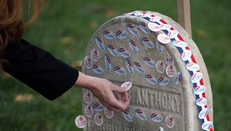 """Voters lined up on election day to place """"I voted"""" stickers on the grave of Susan B. Anthony at Mt. Hope Cemetery. Mandatory Credit: Max Schulte/Democrat and Chronicle via USA TODAY NETWORK *** Please Use Credit from Credit Field ***"""