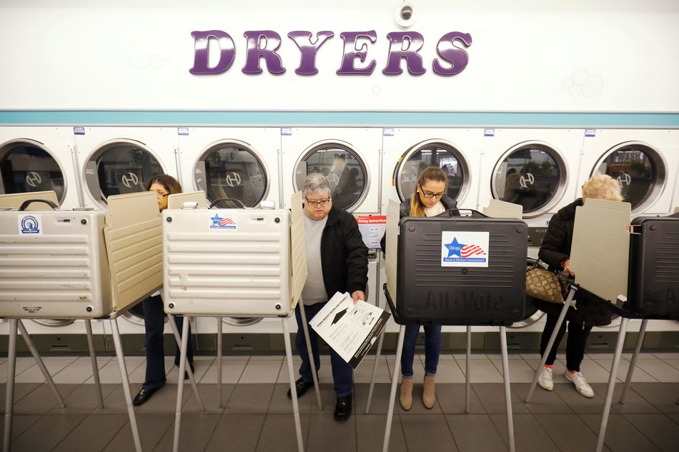 Voter Rojeli Flores casts his ballot in the midterm election at Sunueva Laundromat in Chicago.