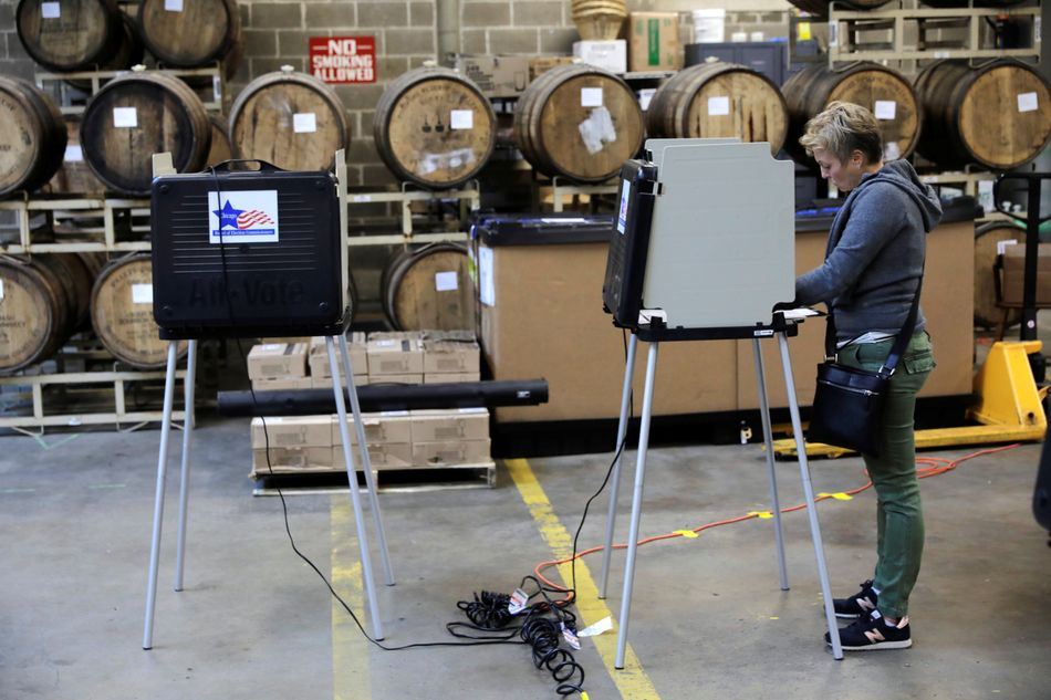 Voter Yvette Pryor casts her ballot at in the midterm election at the Half Acre brewery in Chicago.