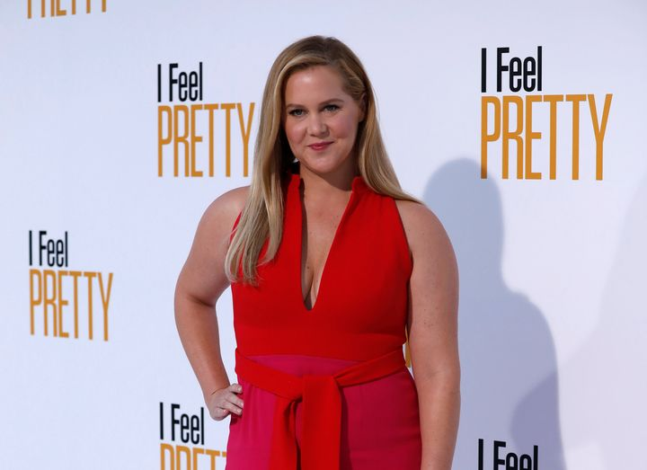 "Amy Schumer arrives at the premiere of ""I Feel Pretty."""