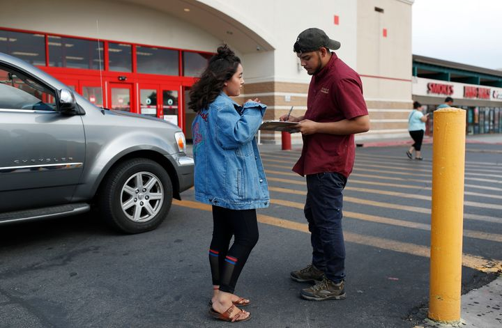 Jazmin Cortez registers Victor Arias to vote in Las Vegas in August. In a year in which the GOP targeted immigration as