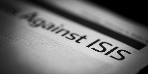 ISIS written newspaper, shallow dof, real newspaper.
