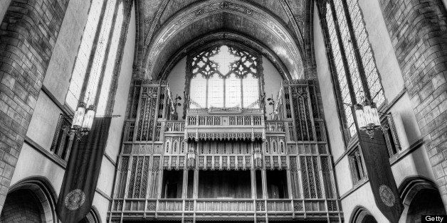 Black and white photo looking down center isle of Rockafeller Cathedral at University of Chicago.