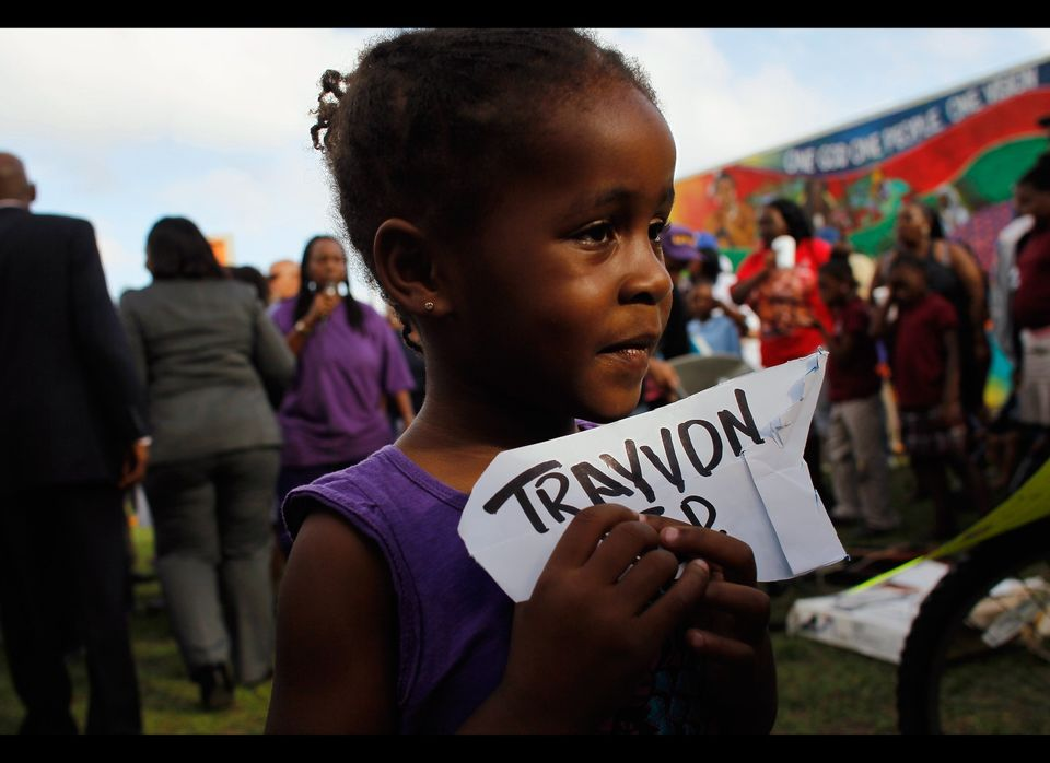 MIAMI, FL - MARCH 21:  Haylie Williams,4, shows her support with the family of 17-year-old Trayvon Martin, who was killed by