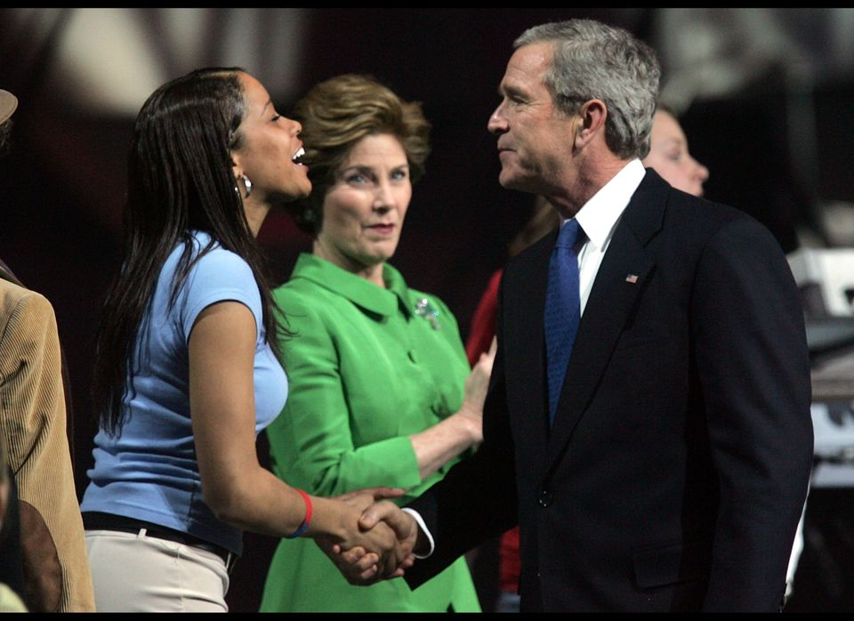 WASHINGTON - JANUARY 18: US President George W. Bush (R) greets 2003 Miss America Erika Harold (L) as his Wife Laura Bush (C)