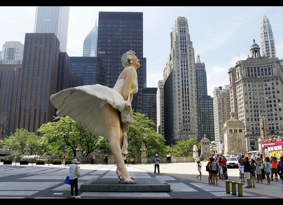 In this July 15, 2011 file photo, curious spectators gather around Seward Johnson's 25-foot-tall sculpture of Marilyn Monroe