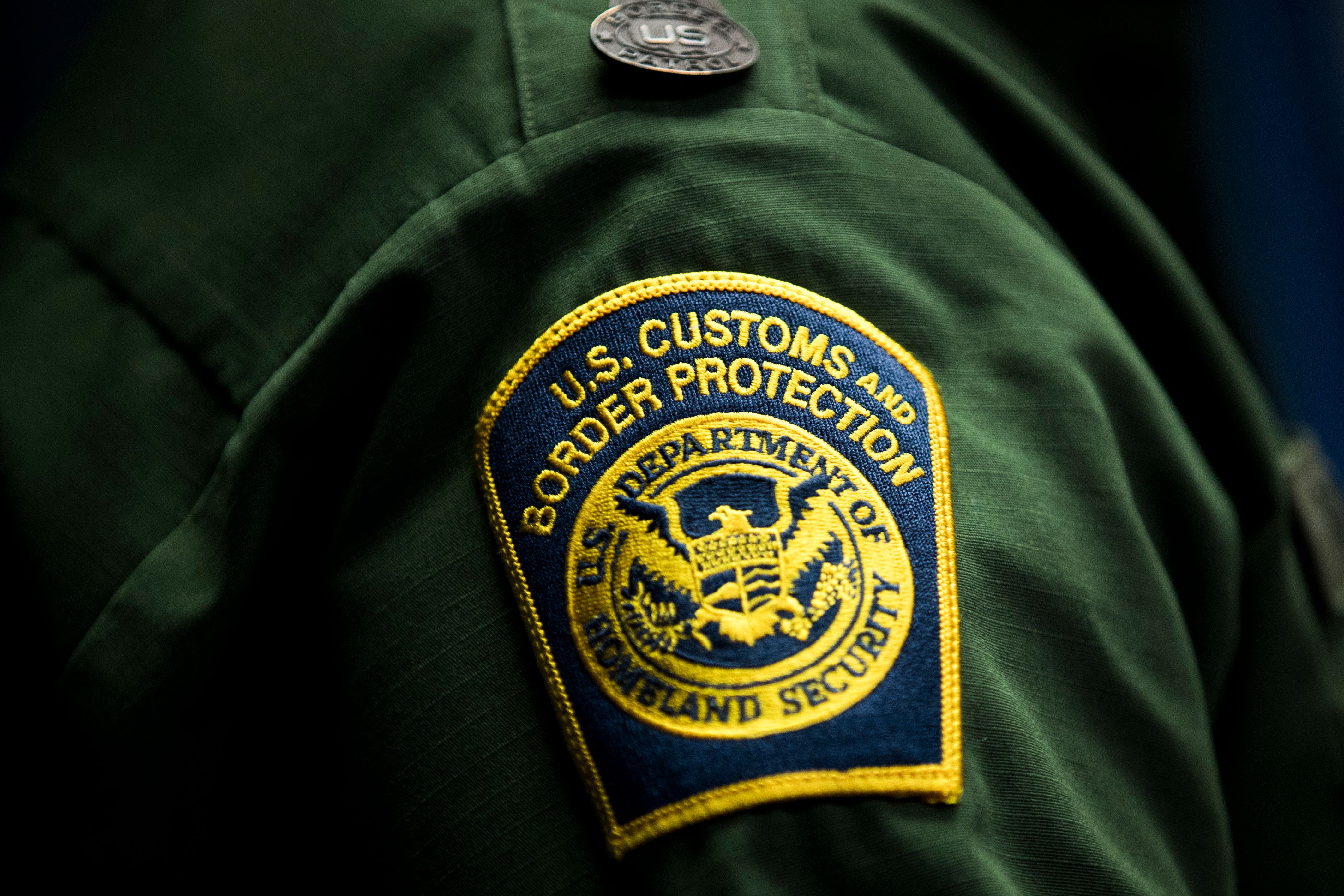 WASHINGTON, DC - DECEMBER 5: A  U.S. Customs and Border Protection patch is displayed on the sleeve of Ronald D. Vitiello, Acting Deputy Commissioner of U.S. Customs and Border Protection (CBP), as he speaks during a Department of Homeland Security press conference to announce end-of-year numbers regarding immigration enforcement, border security and national security, December 5, 2017 in Washington, DC. (Photo by Drew Angerer/Getty Images)