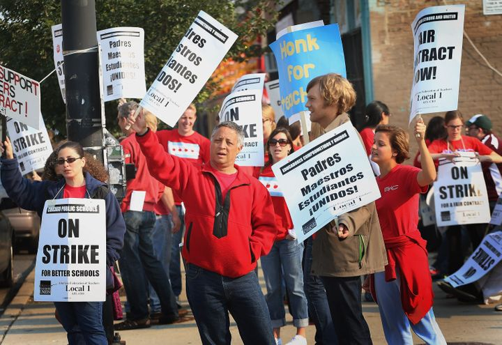 CHICAGO, IL - SEPTEMBER 17:  Striking Chicago public school teachers picket outside of the Jose De Diego Community Academy on