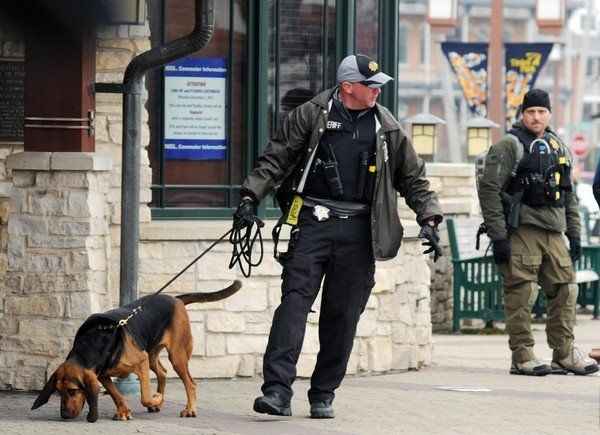"""Police and a K9 officer search the Metra station in downtown Tinley Park, Ill.  (<a href=""""http://tinleypark.patch.com/article"""