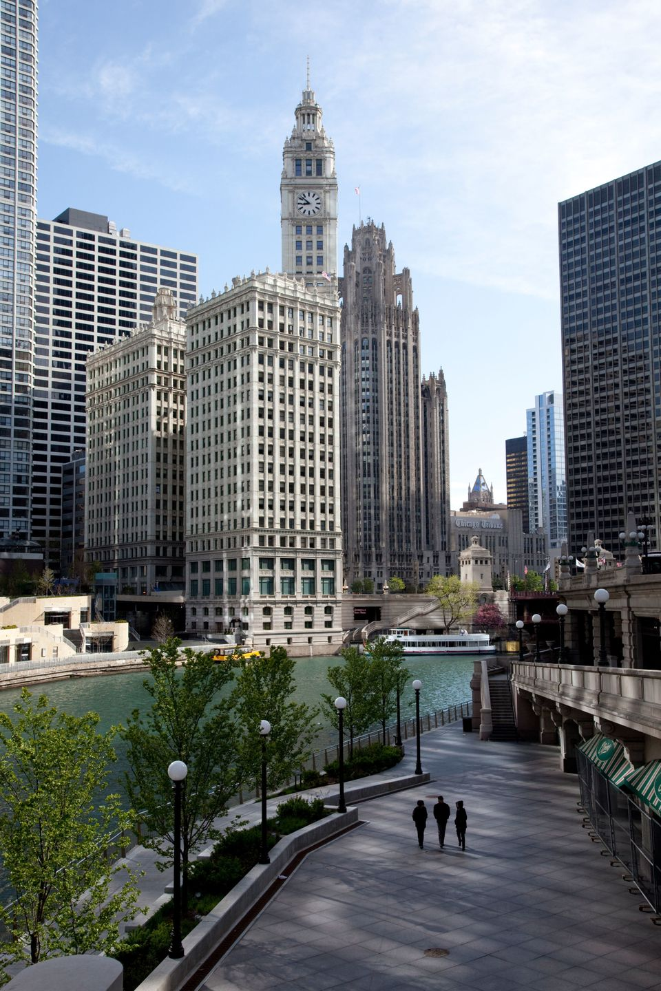 A view of the Wrigley Building and Tribune Tower witha dyed green Chicago River below.