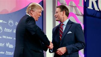 President Donald Trump shakes hands with Family Research Council president Tony Perkins at the 2017 Value Voters Summit, Friday, Oct. 13, 2017, in Washington. (AP Photo/Evan Vucci)