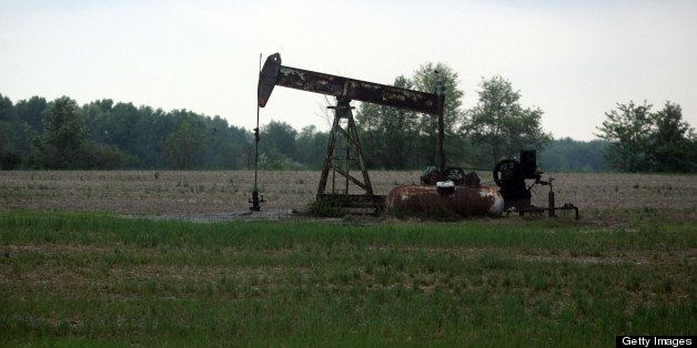 A pump jack works on Wednesday, April 4, 2012, in Cisne, Illinois, as nearby areas are marked for the start of fracking opera