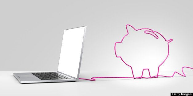Laptop computer with a pink ethernet cable forming a piggy bank, coming out of the back on a plain background