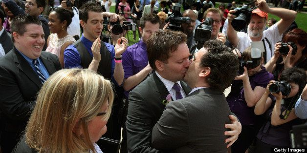 CHICAGO, IL - JUNE 02:  Robert Hunt (L) and Frank Baiocchi kiss after exchang vows during a civil union ceremony in Millenniu