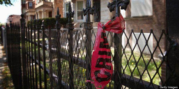 CHICAGO, IL - MAY 13:  Crime scene tape hangs from a fence near the location where 21-year-old Ronald Baskin was shot and kil