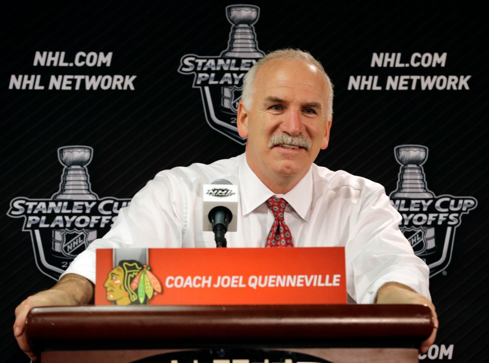 Chicago Blackhawks head coach Joel Quenneville smiles during a news conference after the Blackhawks' 4-3 win over Los Angeles