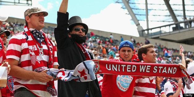 CHICAGO, IL - JULY 28:  Fans of the United States cheer as their team enters the field for warm-ups before taking on Panama d