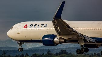 Zurich, Switzerland - August 7, 2018: A Boeing 767 of Delta Air Lines lands on runway 14 of Zurich Airport in the morning. The aircraft with the registration N189DN was delivered to the airline on 13th February 1997. The photo was taken outside the airport.