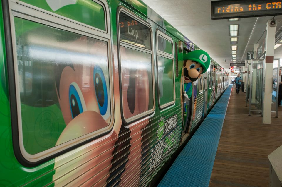 In this photo provided by Nintendo of America, Luigi gets ready for his morning commute on the Luigi-themed Chicago 'L' Train