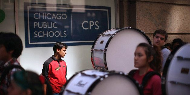 CHICAGO, IL - JULY 11:  Members of the Kelly High School marching band drum line lead demonstrators to the Chicago Public Sch