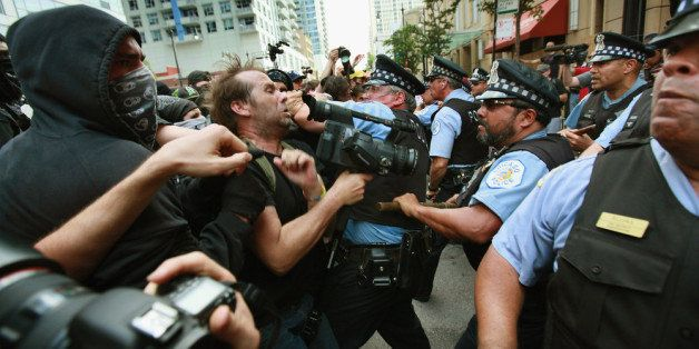 CHICAGO, IL - MAY 20:  Police clash with demonstrators protesting the NATO Summit during a march through downtown streets on