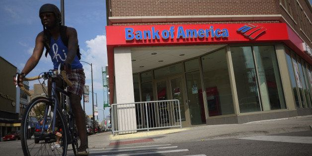 CHICAGO, IL - SEPTEMBER 12:  A cyclist rides past a Bank of America branch on September 12, 2011 in Chicago, Illinois.  Bank