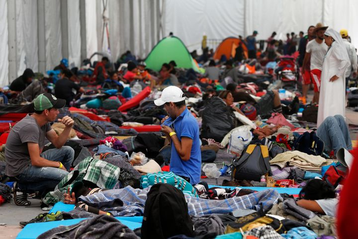 Central American migrants settle in a shelter at the Jesus Martinez stadium in Mexico City, Tuesday, Nov. 6, 2018.