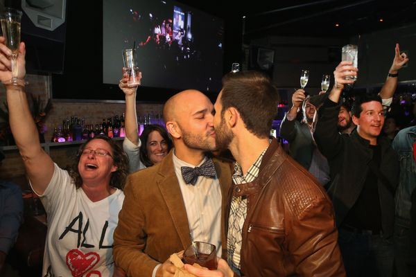Fernando Mojica (L) celebrates with Drew Freeman at Sidetrack after the Illinois General Assembly approved a gay marriage bil