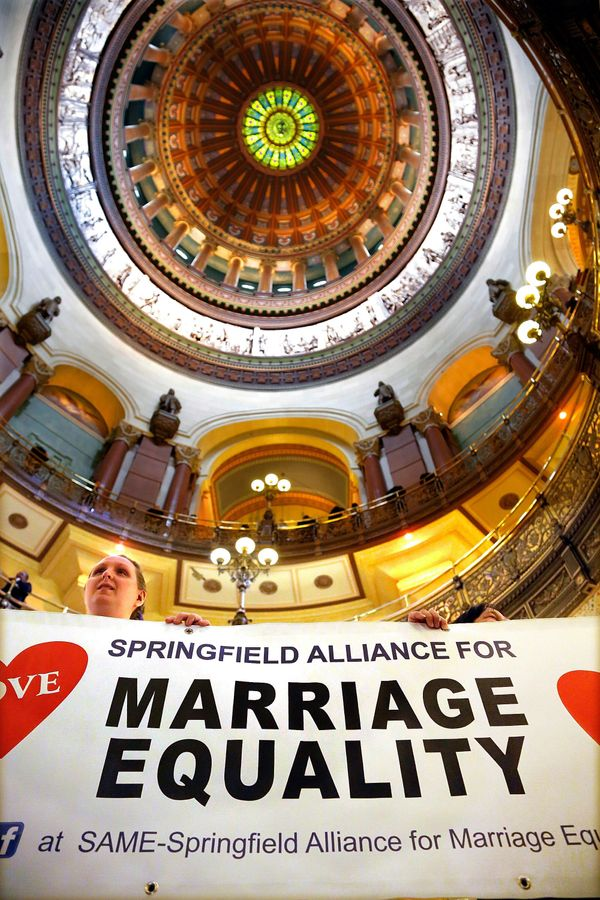 Supporters of the marriage equality bill rally in the rotunda at the Illinois State Capitol during veto session Tuesday, Nov.
