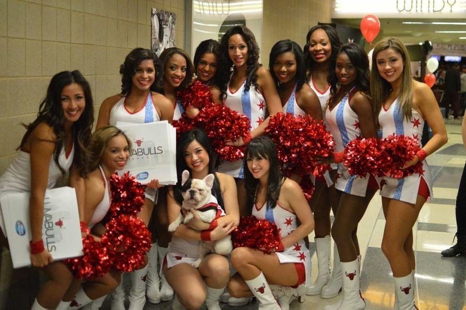 The Luvabulls take a minute to pose with their four-legged fan.