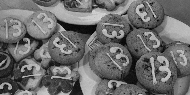 Baked cookies bearing the number 13, being served at the anti-superstition party.  (Photo by William C. Shrout//Time Life Pic