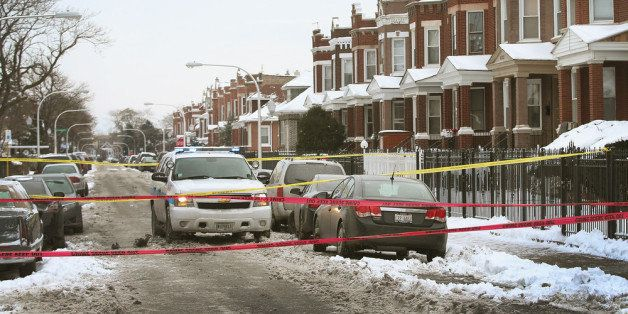 CHICAGO, IL - DECEMBER 15:  Police investigate a homicide scene after a 24-year-old man was found dead with a gunshot to his