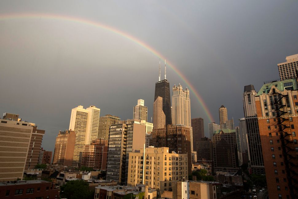 A rainbow appears over Chicago after a quick rain shower, Monday, June 17, 2013. (AP Photo/Scott Eisen)
