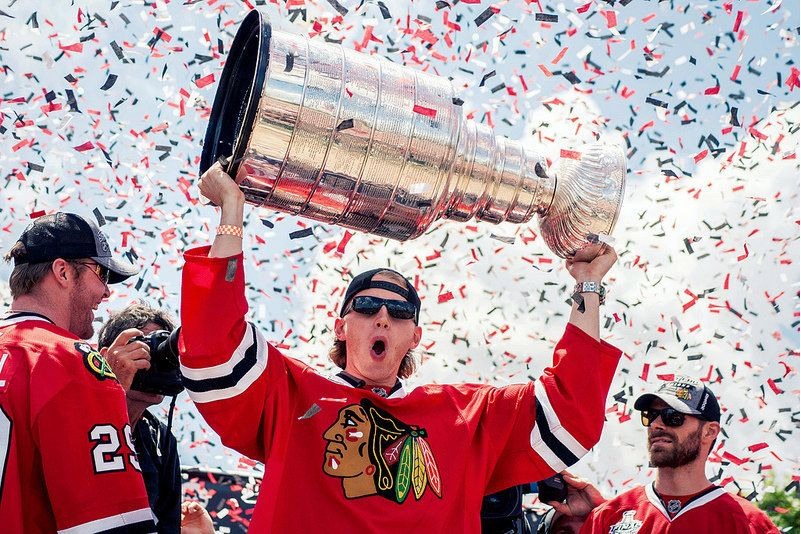 Patrick Kane holds the Stanley Cup in Grant Park.