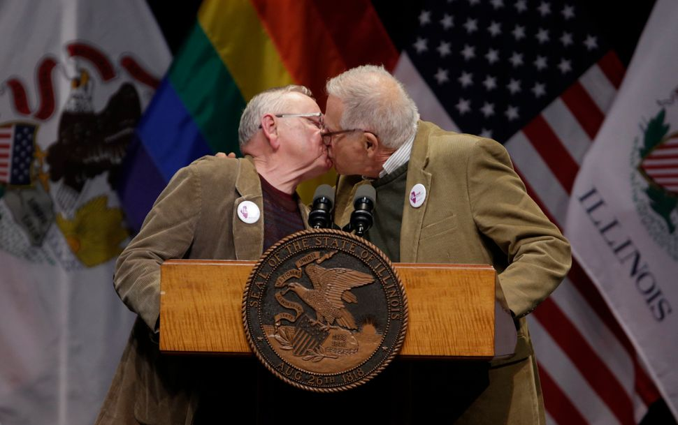 Lifelong partners Jim Darby, left, and Patrick Bova kiss before Illinois Gov. Pat Quinn signed the Religious Freedom and Marr