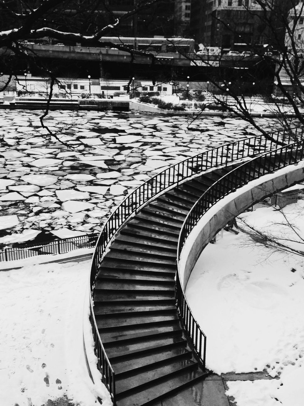The Chicago River covered in ice planks.