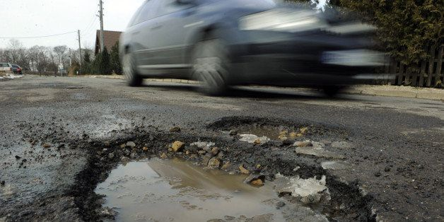FILES - Picture taken on March 8, 2010 shows a car drving past a pothole in Niederzimmern, east central Germany. A novel idea