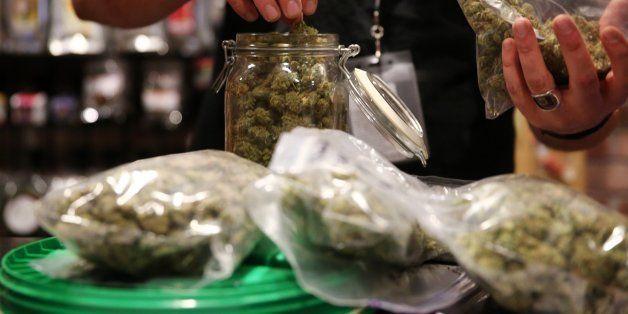 Assistant manager Dunn Ericson refills a jar of medical marijuana at the River Rock Medical Marijuana Center in Denver, Color