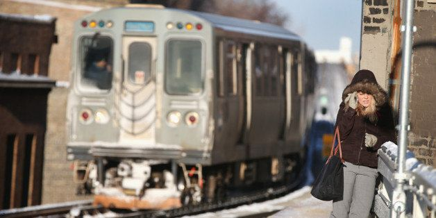 CHICAGO, IL - JANUARY 07:  A passenger waits on an 'L' platform for the train to arrive in below zero temperatures on January