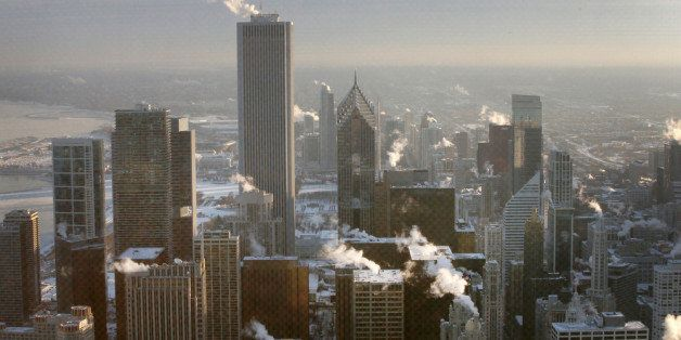 CHICAGO, IL - JANUARY 07:  Steam rises from downtown buildings as temperature begin to climb above zero for the first time in