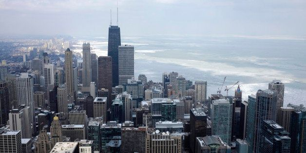 Ice covered Lake Michigan is seen behind downtown skyline Tuesday, Feb. 17, 2015, in Chicago. Burst of frigid air is expected