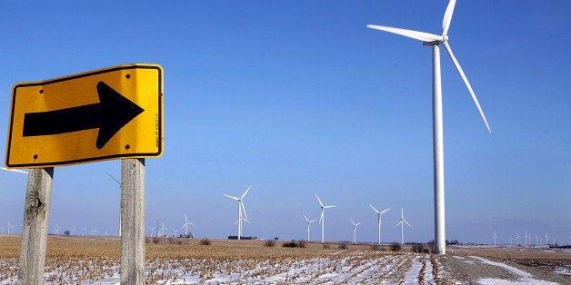 Wind powered turbines look like iron giants in a farmers field near Arrowsmith, Ill., Friday Dec. 5, 2008. The wind-power ind