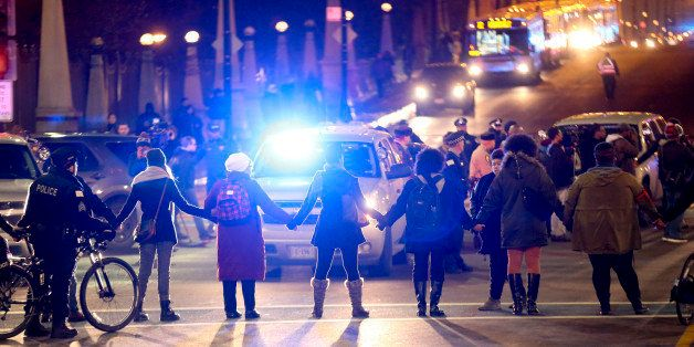 Protesters form a circle at the intersection of South State Street and West Roosevelt Road in Chicago following the release o
