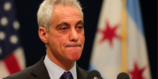 Chicago Mayor Rahm Emanuel bites his lip as he listens to a question from a reporter during a press conference on Tuesday, De